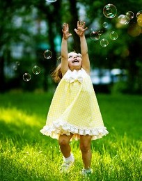 Little Girl Playing with Bubbles - Autism Advocacy